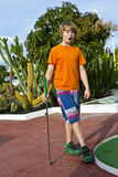 Boy playing mini golf Royalty Free Stock Images