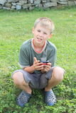 Boy playing with mobil phone Royalty Free Stock Photography
