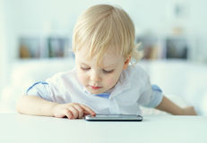 Boy is playing with a mobile phone Royalty Free Stock Photo