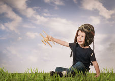Boy playing with a model airplane royalty free stock image