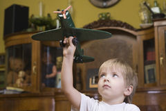 Boy Playing With Model Airplane Stock Images