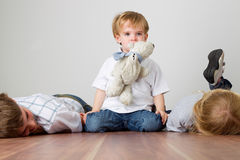 Boy is playing mother cat Royalty Free Stock Images