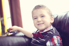 Boy playing with motorbike Royalty Free Stock Photo