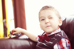 Boy playing with motorbike Royalty Free Stock Photos