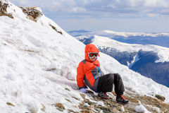 Boy playing on mountain in wintertime. Cute little kid boy in co Stock Photos