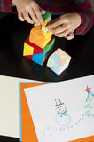 Boy playing with multicolored cubes Royalty Free Stock Photography