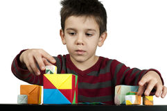Boy playing with multicolored cubes Royalty Free Stock Photos