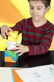 Boy playing with multicolored cubes Stock Image