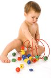 Boy playing with multicolored cubes and curl Royalty Free Stock Images