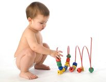 Boy playing with multicolored cubes and curl Stock Images