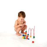Boy playing with multicolored cubes and curl isola Royalty Free Stock Photo