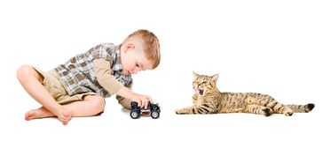 Boy playing near the cat Stock Images