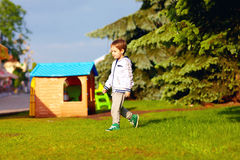 Boy playing near toy house Stock Photos
