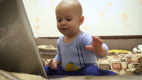 Boy Playing with noteboock stock video