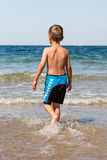 Boy playing in the ocean Royalty Free Stock Photos