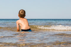 Boy playing in the ocean Royalty Free Stock Images