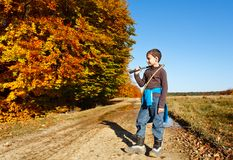 Boy playing outdoor Royalty Free Stock Image