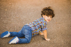 Boy playing outdoors Royalty Free Stock Photography