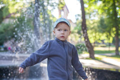 Boy playing outdoors. Looking at the camera royalty free stock photos