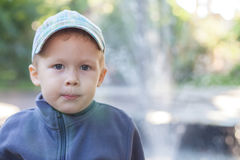 Boy playing outdoors. Looking at the camera stock photography