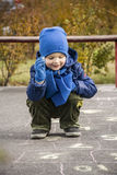 Boy playing outside Stock Photos