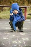Boy playing outside Stock Photo