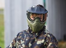 Boy is playing paintball on the field. paintball games can be played on indoor or outdoor fields royalty free stock photography