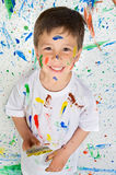 Boy playing with painting Royalty Free Stock Images
