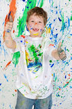 Boy playing with painting Royalty Free Stock Photo