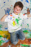 Boy playing with painting Stock Images