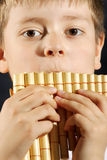 Boy playing panflute Royalty Free Stock Image