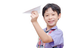 Boy playing with paper airplane Royalty Free Stock Images
