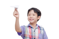 Boy playing with paper airplane Royalty Free Stock Photos