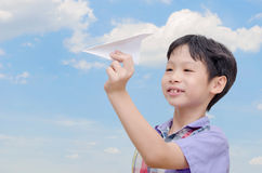 Boy playing with paper airplane Stock Photo