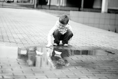 Boy is playing with paper boat Royalty Free Stock Photos