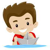 Boy playing Paper Boat in the water Stock Photos