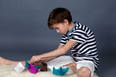 Boy playing with paper boats Royalty Free Stock Photography