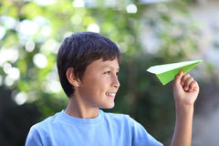 Boy playing with paper plane Stock Photo