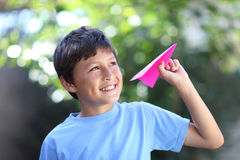 Boy playing with paper plane Stock Images