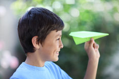Boy playing with paper plane Stock Photos