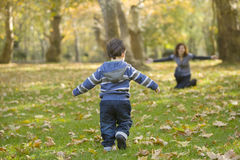 Boy playing in the park Royalty Free Stock Photo