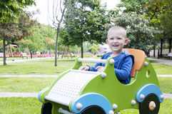 Boy playing in the park Stock Image