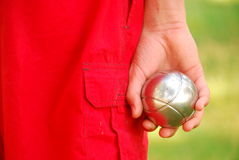 Boy playing petanque Stock Images