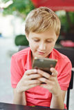 Boy playing phone Stock Photos