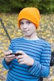 Boy playing on phone stock image