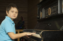 Boy is playing the piano Royalty Free Stock Photos