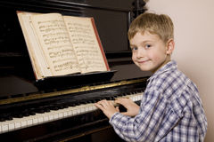 Boy playing the piano Royalty Free Stock Images