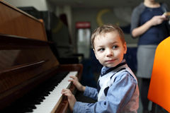Boy playing the piano Stock Image