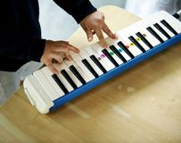 Boy playing piano music toy Stock Images