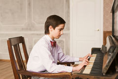 Boy Playing Piano Royalty Free Stock Images